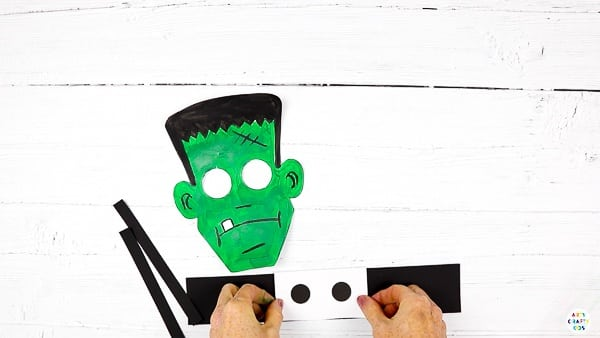 Cut out the Frankenstein elements from the template. Create three paper strips