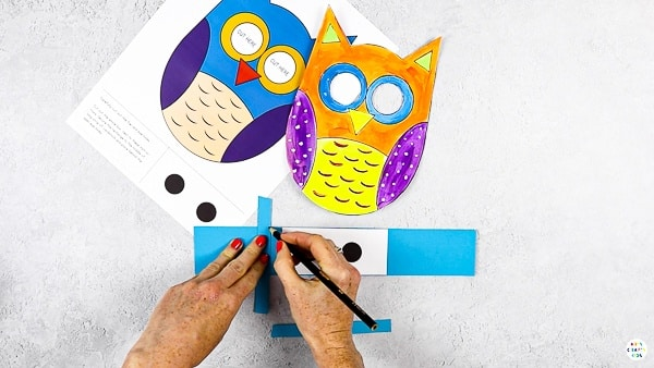 Create two smaller strips to secure behind the eye holes of the owl.