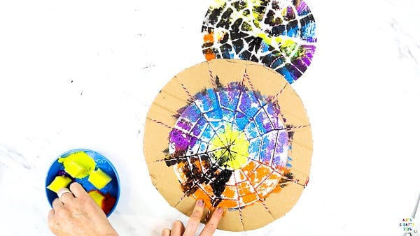 String Halloween Spider Web Art: Using a sponge, paint across the string with bright and bold colors.