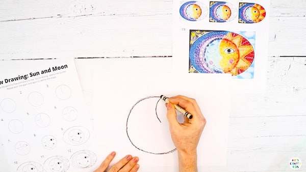 Next, divide the circle to create two distinct faces - sun and moon.