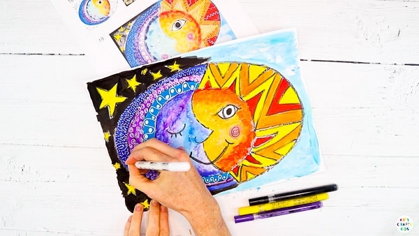 Leave the sun and moon art to draw. Once dry, add detail by doodling on top of the paint.