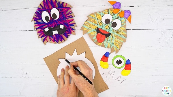 Trace the monster body onto a piece of scrap cardboard.