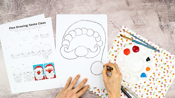 Again, starting from the left moustache draw a large overarching semi-circle to create Santa's hat.
