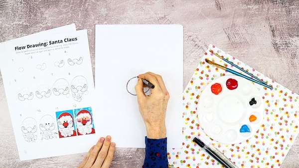 Start by drawing Santa's nose in a central position on the cardstock.
