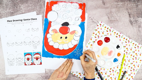 Using an acrylic marker, draw snowflakes onto the blue background.