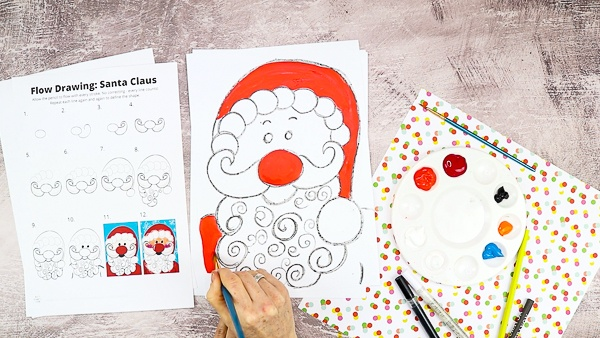 Let's start painting! Add the bold colors first - red for Santa's hat and coat. Blue for the background.