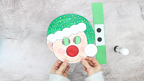 Picture showing elf with empty eyes and green backing strips.
