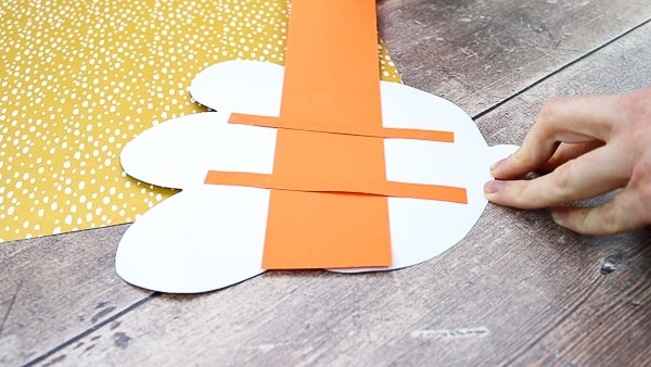 Slide the eye strip under the support strips.