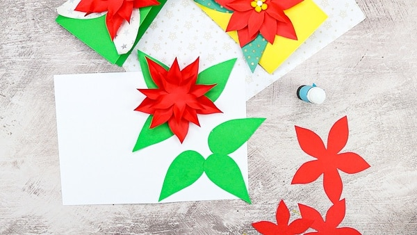 Add a third and final layer of poinsettia petals.
