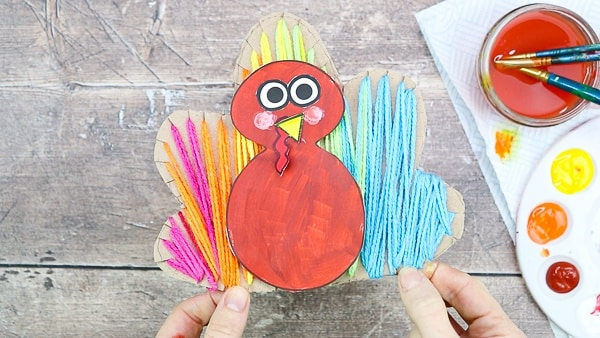 Yarn Wrapped Turkey Craft: A tactile craft for Thanksgiving - Incorporating painting, cutting, threading and sticking, there's plenty to keep children busy, and strengthen little ones fine motor skills whilst they're at it. And children will love getting so hands-on and creative with the different elements.