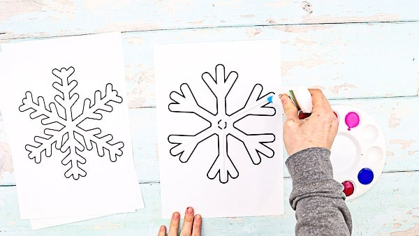 Print the snowflakes templates.   Create gluey lines within the snowflake.