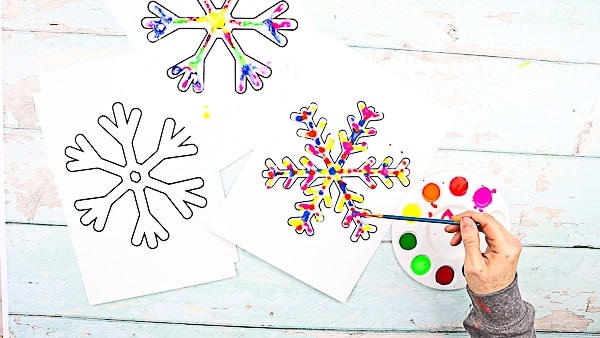 Raised Salt Painted Rainbow Snowflakes: Part art, part experiment, this easy Winter craft is a fun and engaging way to combine art and science.