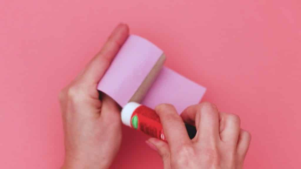 Secure the ends of the construction paper.