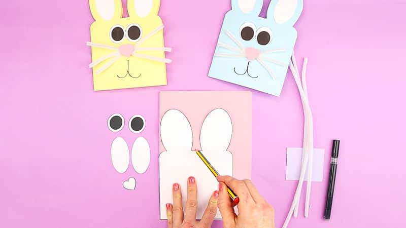 Image showing the bunny template being traced around with a pencil.