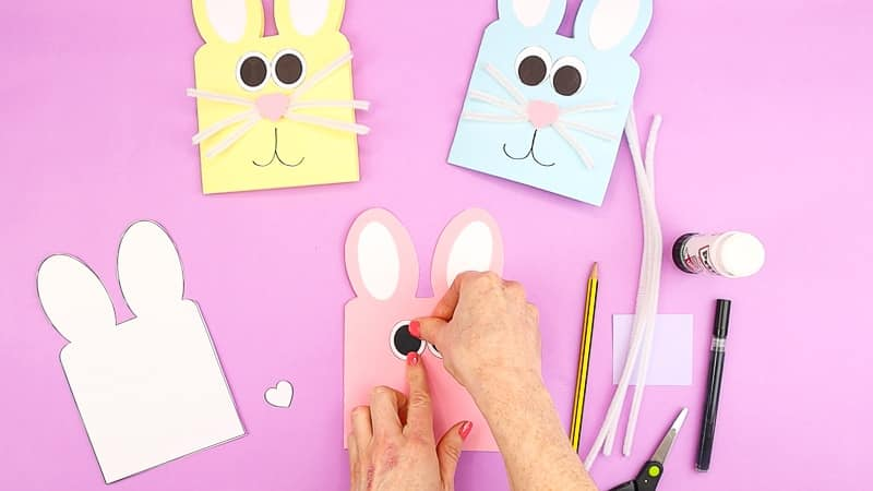 Image showing hands gluing the bunny eyes.