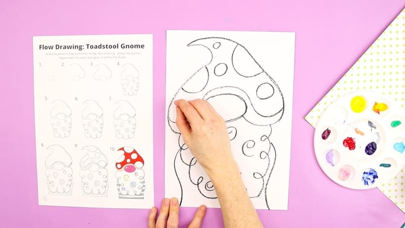 The gnome drawing tutorial is completed with spots added to the hat, to accentuate the image of a toadstool.