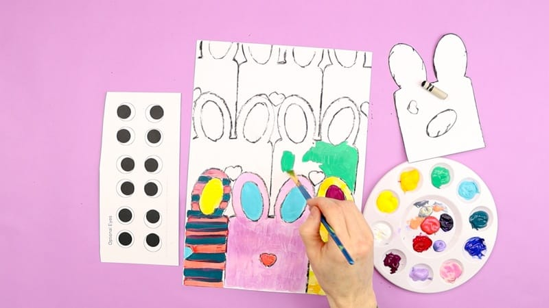 Image showing the bunnies being painted in bright, bold and contrasting colors and patterns.