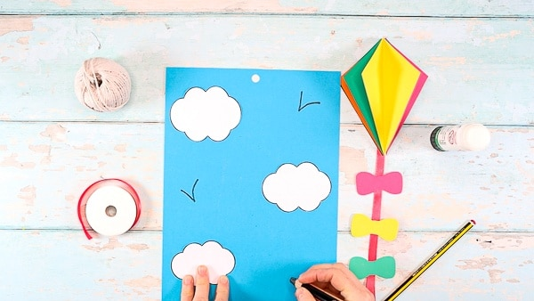 Image showing white clouds glued to blue card stock.