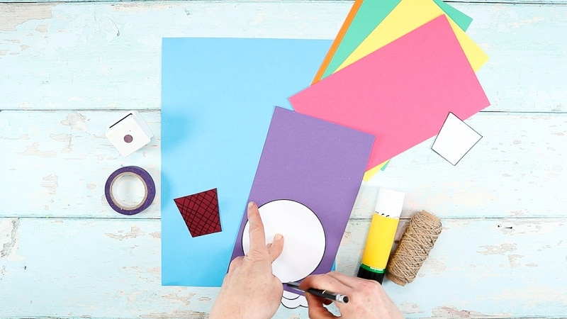 Image showing the circle element being traced onto colored card stock.