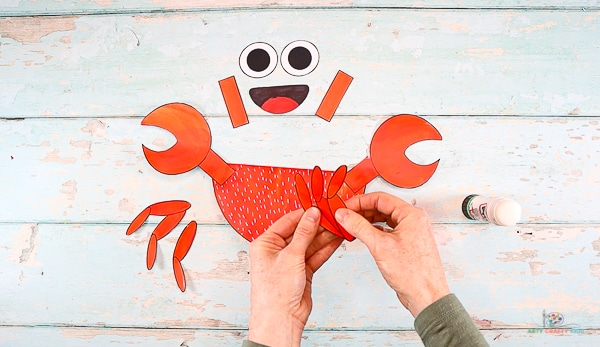Assemble the crab legs, laying one above the other and fan to carefully separate.