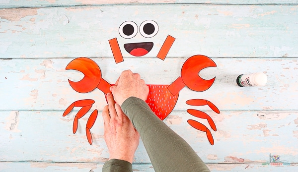 Assemble the crabs claws and affix to the body.