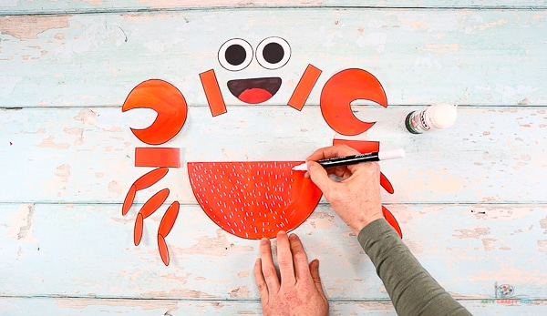 Add decorative detail to the crabs body using a contrasting color.