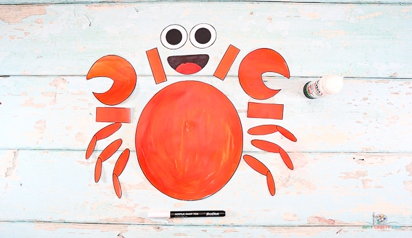 Cut out the paper crab elements and arrange the pieces.