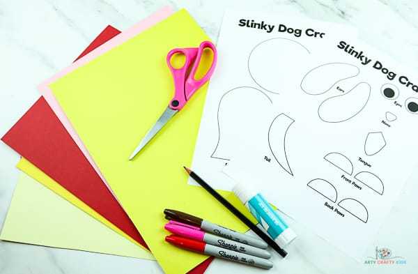 Download the slinky dog craft template and gather supplies.