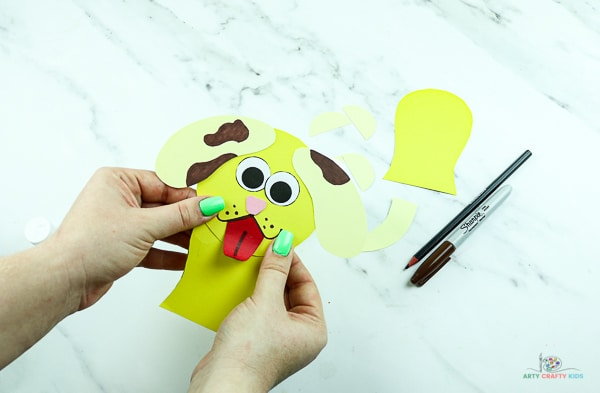 Begin assembling the slinky dog, starting with its head and front legs.