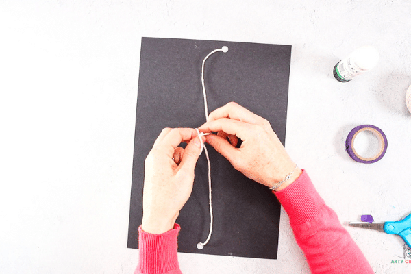 Turn the space backdrop over and secure the string with a knot.