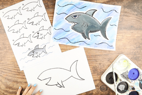 Complete the outline of the shark with a short line joining the mouth and upper arch.