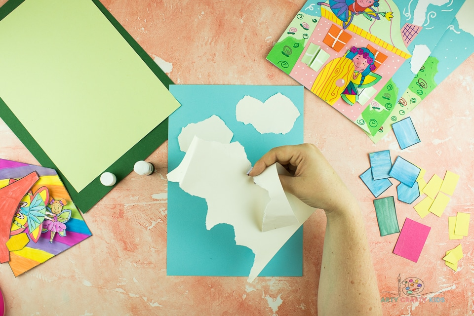 Image showing white paper being torn in to a cloud shape.