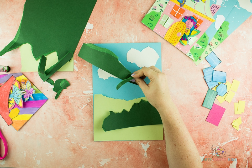 Image showing green card being torn in to shapes to look like hills and bushes.