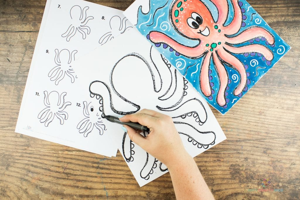 Image showing the semi circle suckers being drawn on the Octopus' tentacles on the left side.