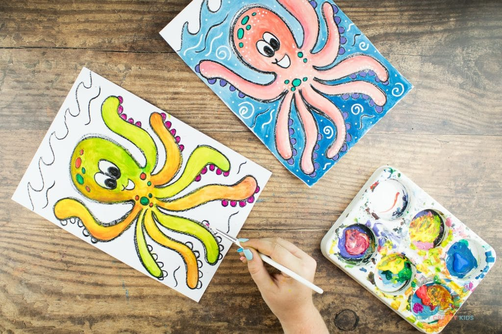 Image showing bright orange, green and pink paint being painted on to the Octopus drawing.