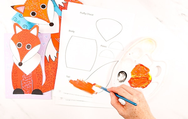 Image showing the beginnings of the fox craft with a fox template painted orange.