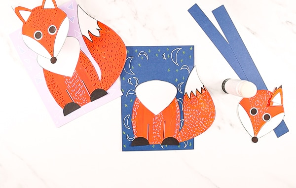 3D Paper Fox Craft - image showing white chest secured to the top of the body and two semi-circle feet glued to the bottom of the fox's body.